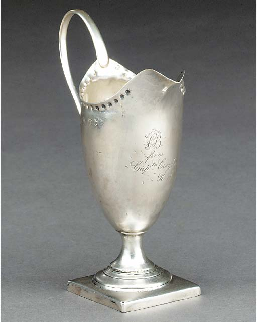 AN URN-SHAPED PLAIN SILVER CRE