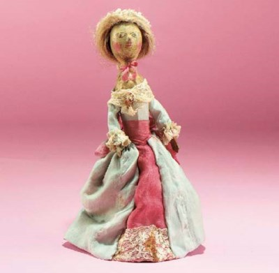A turned and carved wood doll