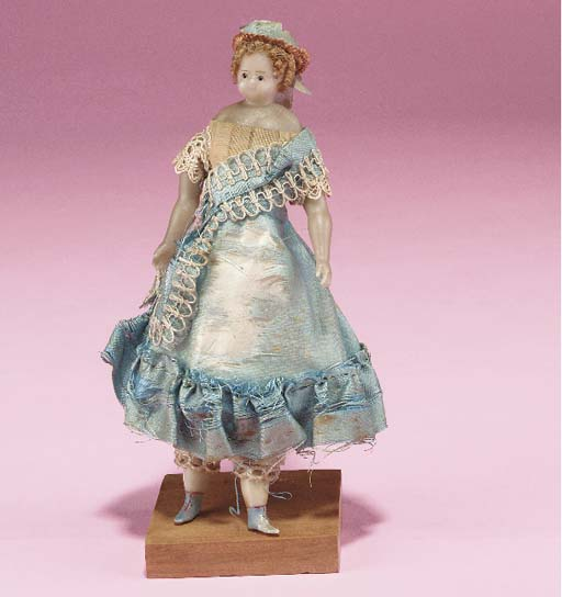 A poured wax dolls' house doll