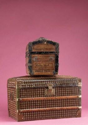 A dolls' wooden trunk