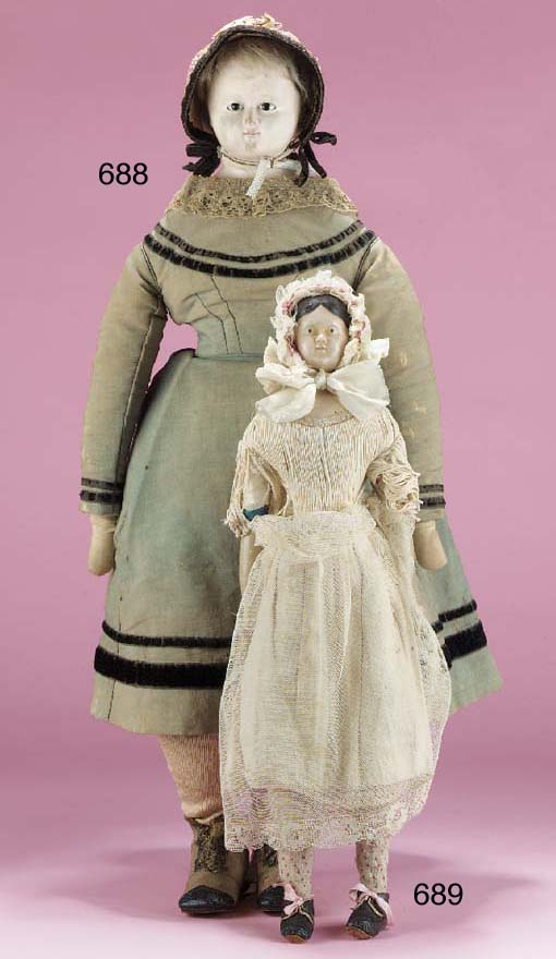 A papier-mâché headed doll