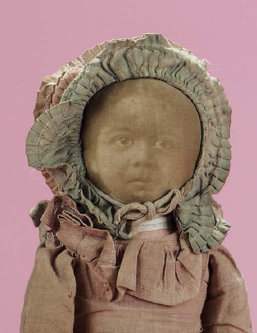 An unusual American cloth doll