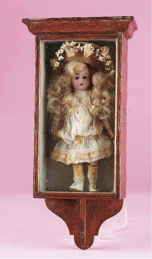 A bisque headed child doll in