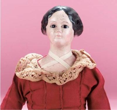A papier-mâché shoulder-headed