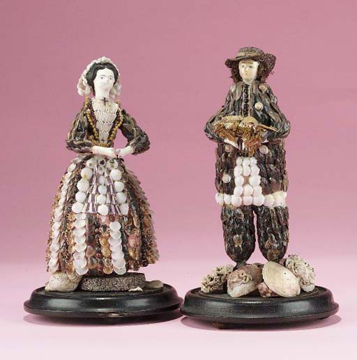 A pair of shell figures