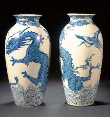 A PAIR OF POTTERY VASES by The