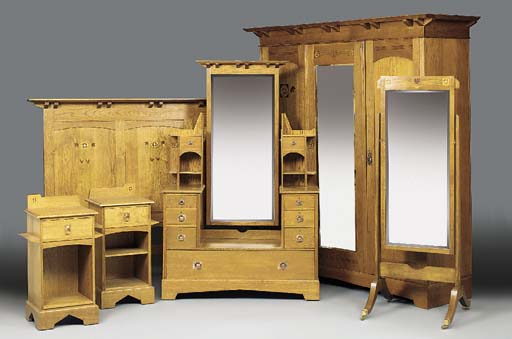 AN INLAID OAK BEDROOM SUITE