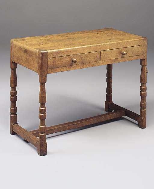 AN OAK HALL TABLE By Robert 'M