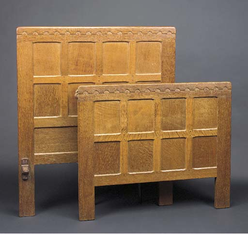 A CARVED OAK SINGLE BED by Rob