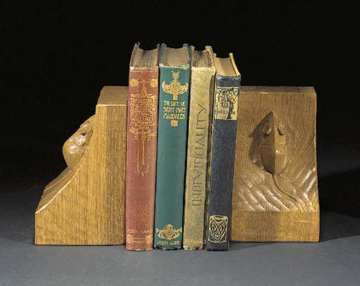 A PAIR OF OAK BOOKENDS by Robe