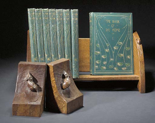 A PAIR OF OAK BOOK ENDS by Rob
