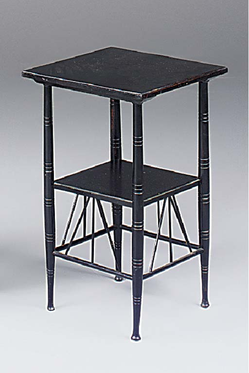 AN EBONISED OCCASIONAL TABLE I