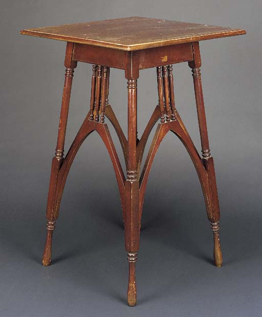 A MAHOGANY TABLE designed by M
