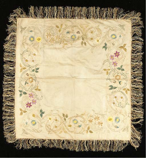 AN EMBROIDERED TABLE COVER
