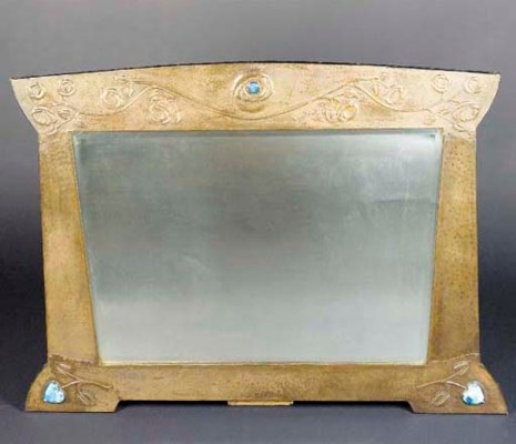 A PATINATED COPPER MIRROR POSS