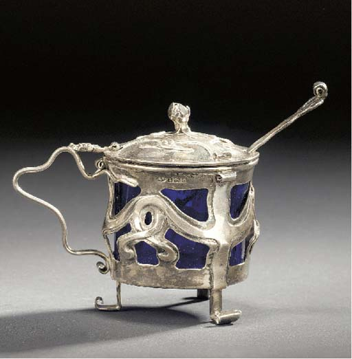 A SILVER MUSTARD POT AND SPOON