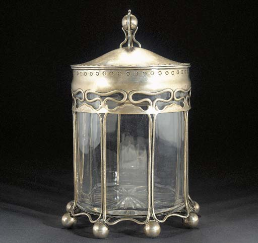 A CONTINENTAL SILVER AND GLASS
