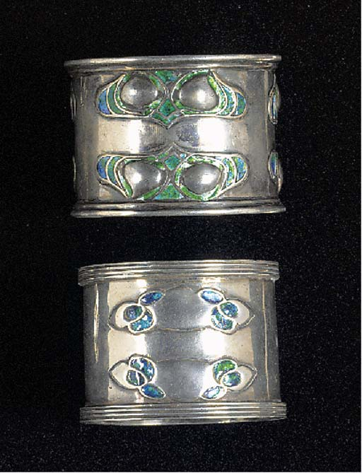 TWO SILVER AND ENAMEL NAPKIN R