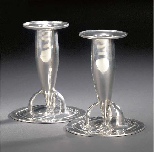 A PAIR OF TUDRIC PEWTER CANDLE