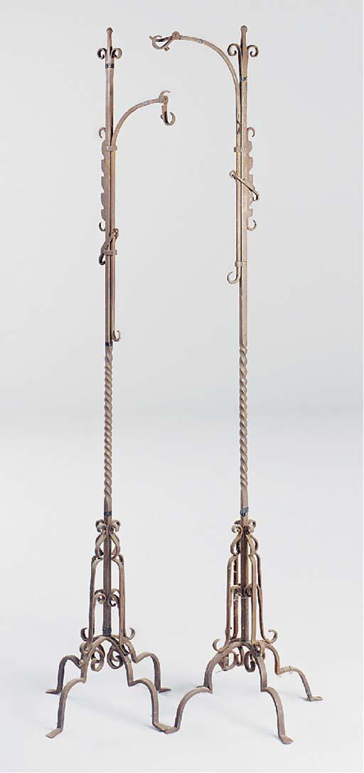 A pair of wrought iron adjusta