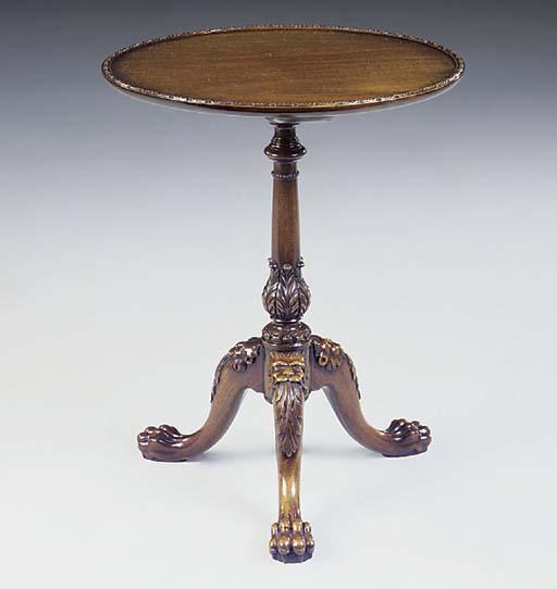 A mahogany tripod table, 20th