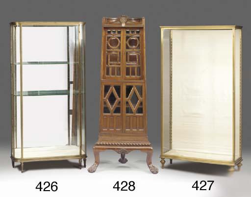 A gilt brass display cabinet,