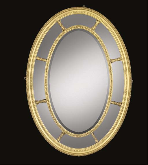 An oval giltwood and compositi
