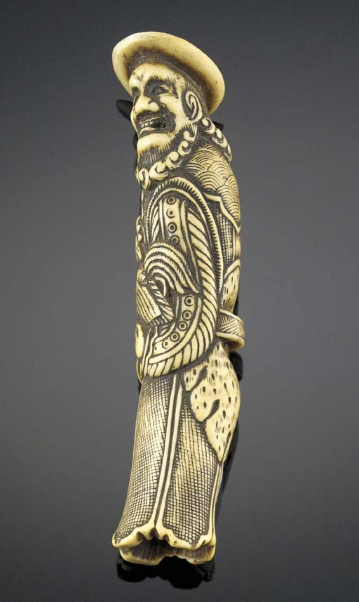 A large stag-horn netsuke of a