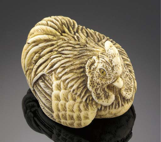 An ivory netsuke of a rooster