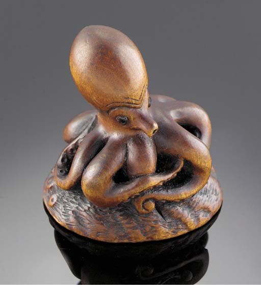 A wood netsuke of an octopus i