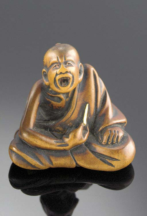 A wood netsuke of a profession
