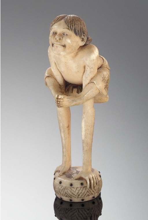 An ivory netsuke of Tenaga 19t