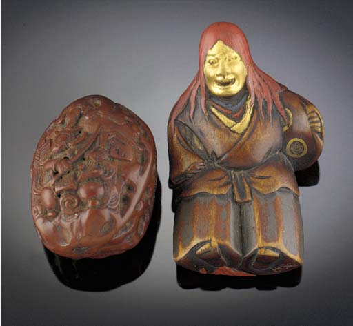 A wood netsuke of a hannya dan
