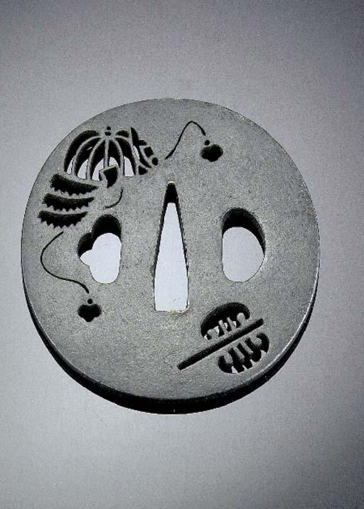A circular iron tsuba Edo Peri