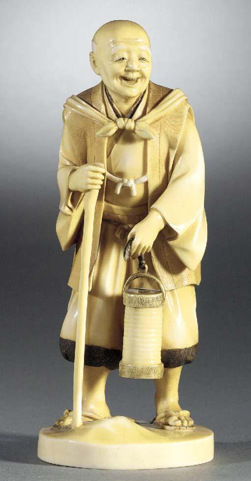 An ivory okimono of a man 19th