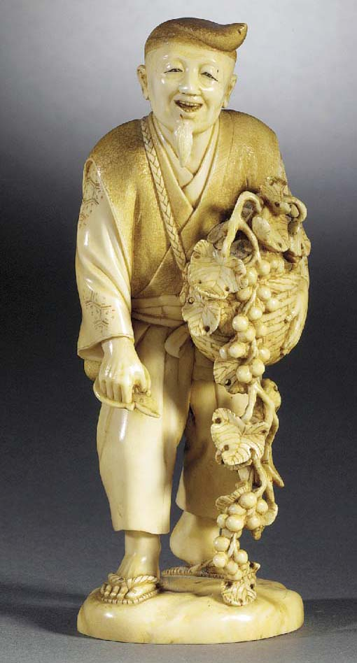An ivory okimono of a fruit se