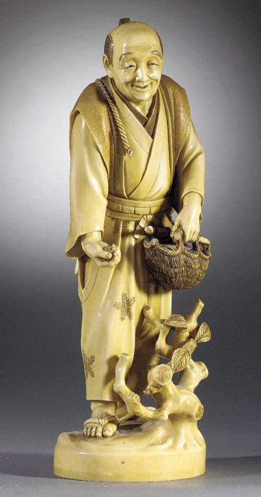 A large ivory okimono of a far