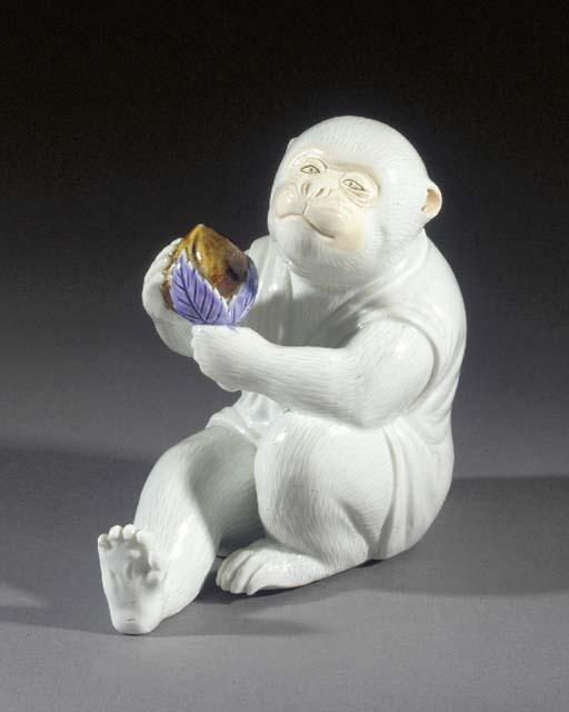 A Hirado white glazed model of a monkey Meiji Period