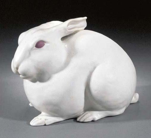 A white glazed model of a rabbit signed Banko Fueki, Meiji Period