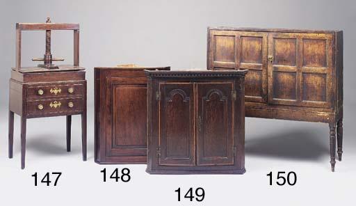 An oak book or clothes press,