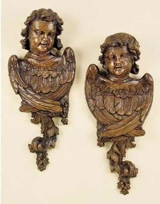 A pair of Continental carved a