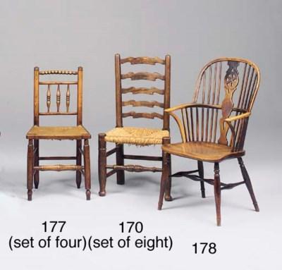 A set of eight oak ladderback