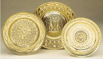 Three Continental brass alms d