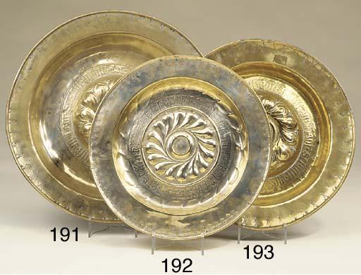 A Nuremberg brass alms dish, p