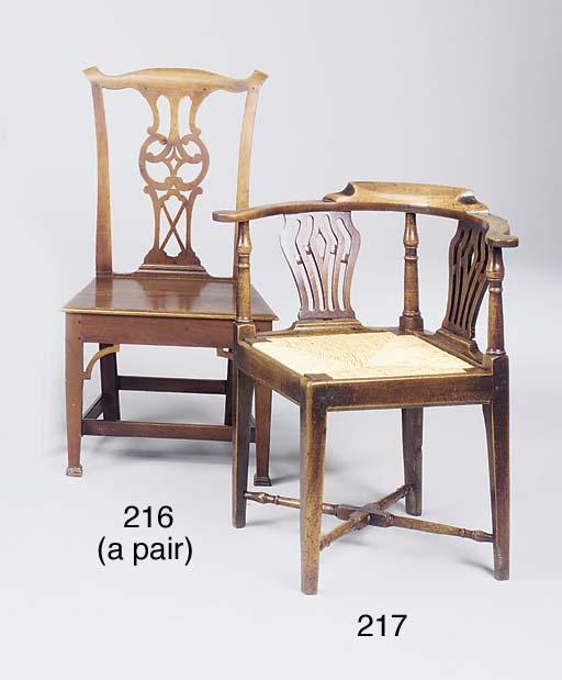 A pair of walnut solid seat ha