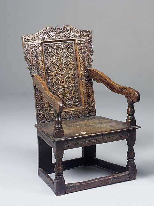 An oak panel back armchair, Yo