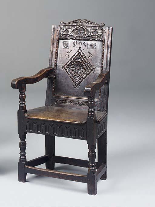 An oak panel back armchair, En