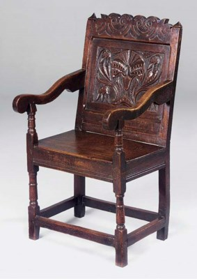 An oak panel back armchair, No