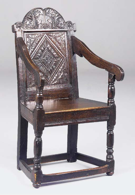 An oak panel back armchair, En