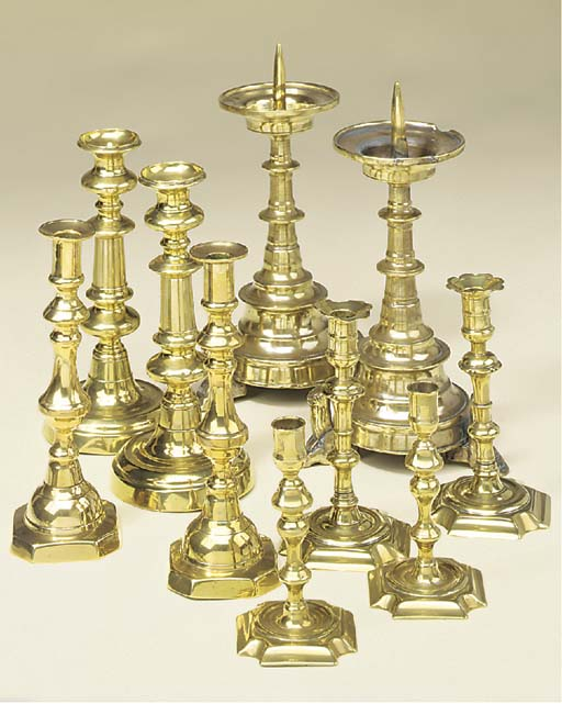 Five pairs of brass candlestic